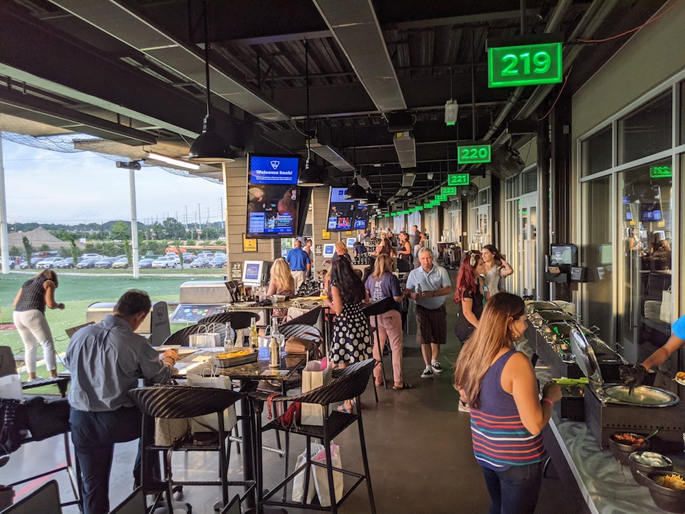 TopGolf outside golfing and eating